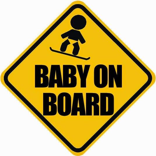 baby snowboarder