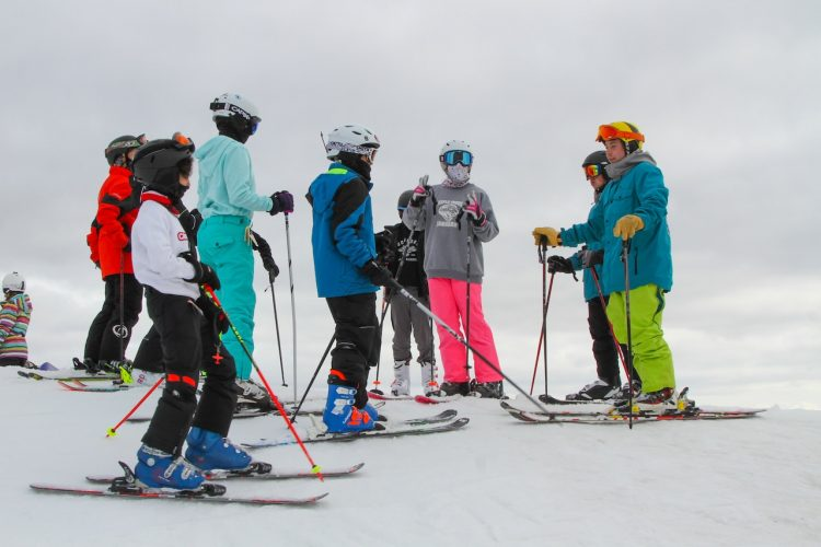 Learn to Ski This Winter at Evolve Camps!